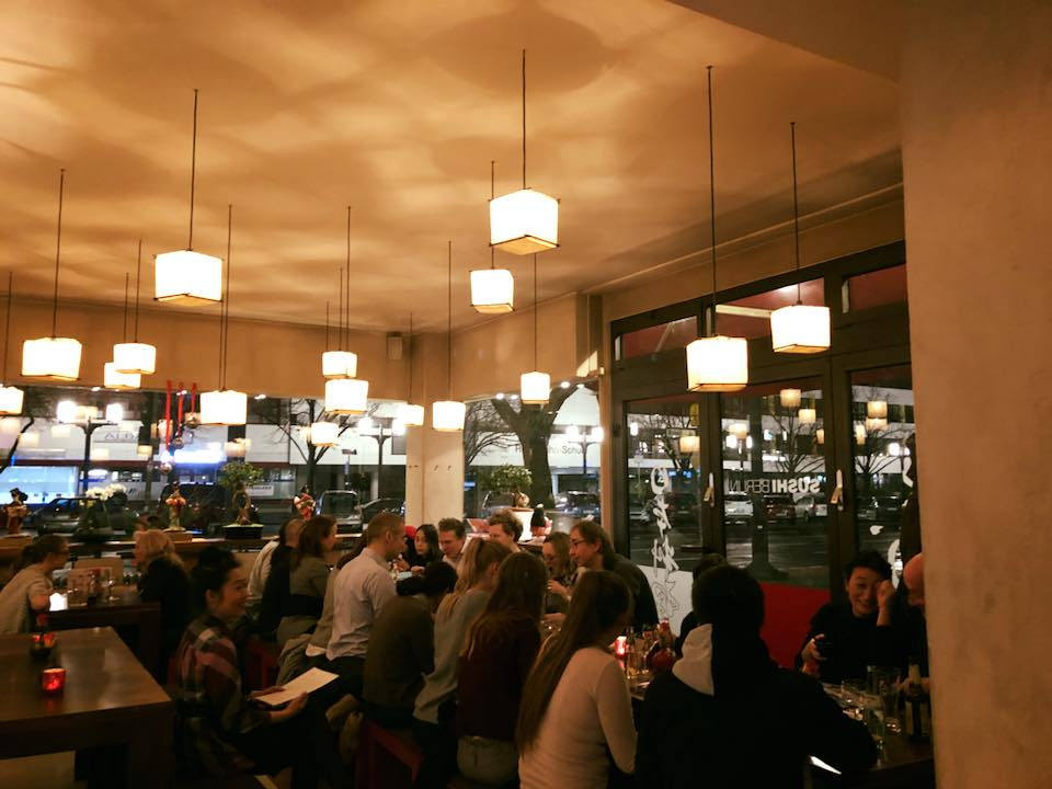 Customers and cubic lamps at Sushi Berlin