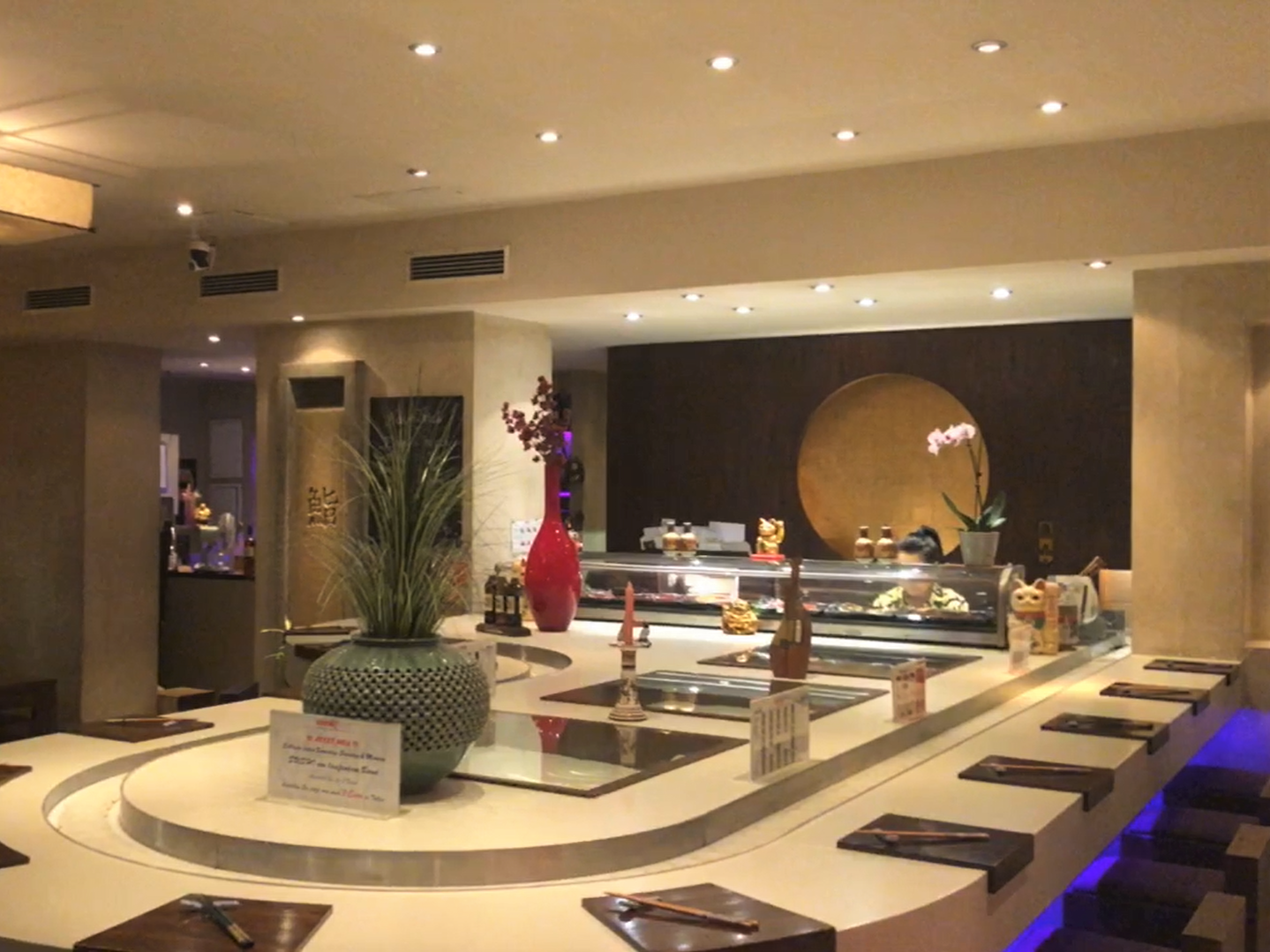 Sushi bar with sushi train and japanese decoration at Sushi Berlin
